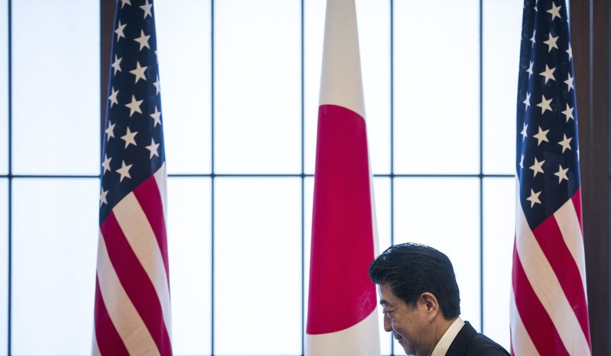 Japan's Prime Minister Shinzo Abe attends the 60th anniversary commemorative reception of the signing of the Japan-US security treaty at the Iikura Guesthouse in Tokyo, Sunday, July 19, 2020. (Behrouz Mehri/Pool Photo via AP)