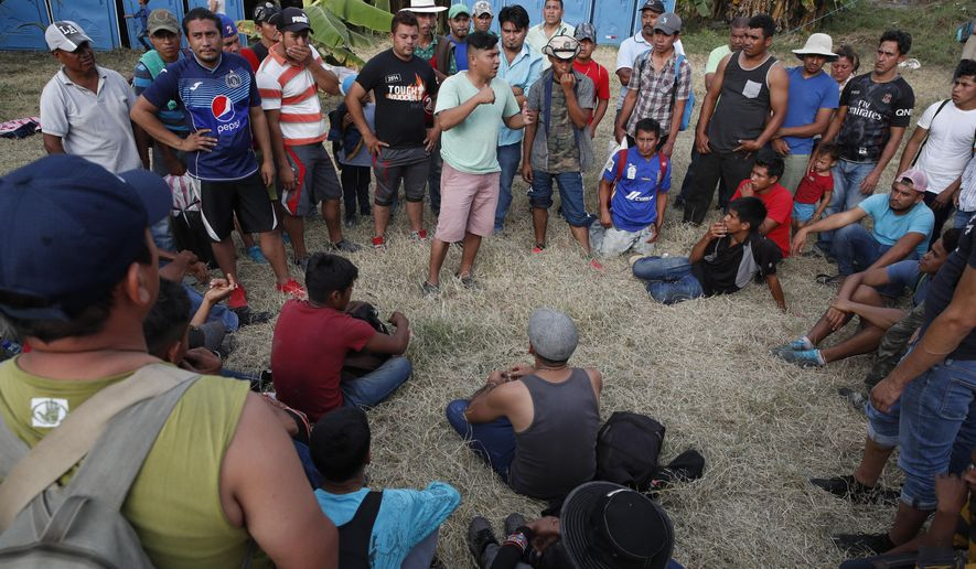 Honduran migrants gather at a temporary shelter in Tecun Uman, Guatemala, on the border with Mexico, Sunday, Jan. 19, 2020. More than 2,000 migrants spent the night in Tecun Uman on the Guatemalan side of the border, uncertain of their next steps. (AP Photo/Moises Castillo)