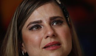 In this Jan. 14, 2020 photo, tears well up in Ana Lucia Salazar's eyes as she tells her story of abuse, during an interview in Mexico City. Salazar says that she was sexually abused by a Legion of Christ priest when she was eight. (AP Photo/Marco Ugarte)