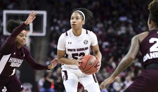 South Carolina guard Tyasha Harris (52) is defended by Mississippi State guard Myah Taylor (1) during the first half of an NCAA college basketball game Monday, Jan. 20, 2020, in Columbia, S.C. (AP Photo/Sean Rayford)