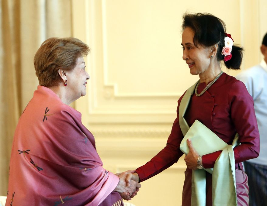 Myanmar's leader Aung San Suu Kyi, right, shakes hands with Philippine diplomat Rosario Manalo, a member of the Independent Commission of Enquiry for Rakhine State, at the Presidential Palace in Naypyitaw, Myanmar, Monday, Jan. 20, 2020. An independent commission established by Myanmar's government and led by Manalo has concluded there are reasons to believe that security forces committed war crimes in counterinsurgency operations that drove more than 700,000 members of the country's Muslim Rohingya minority to flee to neighboring Bangladesh. (AP Photo/Aung Shine Oo)