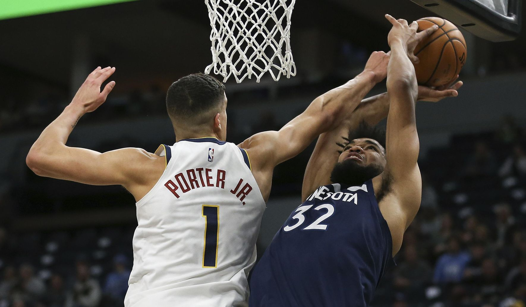 Nuggets_timberwolves_basketball_17967_c50-0-2861-1639_s1770x1032