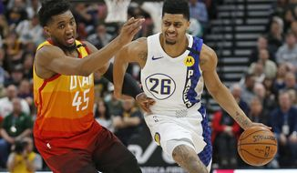 Utah Jazz guard Donovan Mitchell (45) guards Indiana Pacers guard Jeremy Lamb (26) in the first half during an NBA basketball game Monday, Jan. 20, 2020, in Salt Lake City. (AP Photo/Rick Bowmer)