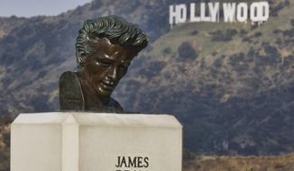 """This Friday, Jan. 17, 2020, photo shows a bust of actor James Dean at the Griffith Observatory in the Griffith Park area of Los Angeles. Travis Cloyd, who is leading the revival of Dean for his appearance in """"Finding Jack,"""" says his company will eventually offer the late actor's digital likeness for a range of roles in movies, TV and video games. (AP Photo/Richard Vogel)"""