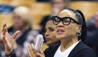 South Carolina head coach Dawn Staley talks to her team from the bench during the second half of an NCAA college basketball game against Missouri Thursday, Jan. 16, 2020, in Columbia, Mo. South Carolina won the game 78-45. (AP Photo/L.G. Patterson)  **FILE**