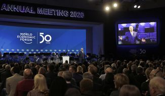 Klaus Schwab, founder of the World Economic Forum, delivers a welcome message on the eve of the annual meeting of the World Forum in Davos, Switzerland, Monday, Jan. 20, 2020. The 50th annual meeting of the forum will take place in Davos from Jan. 21 until Jan. 24, 2020. (AP Photo/Markus Schreiber)