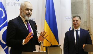 OSCE Chairperson in Office, Albania's Prime Minister Edi Rama, left, and Ukrainian Minister for Foreign Affairs Vadym Prystayko attend a news conference in Kyiv, Ukraine, Monday, Jan. 20, 2020. (AP Photo/Efrem Lukatsky)
