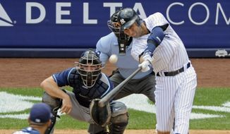 In this July 9, 2011, file photo, New York Yankees' Derek Jeter hits a home run for his 3,000th career hit during the third inning of a baseball game against the Tampa Bay Rays at Yankee Stadium in New York. (AP Photo/Bill Kostroun, File) **FILE**