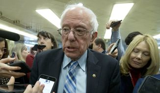Sen. Bernie Sanders, I-Vt., talks to reporters as he arrives at the Senate for the start of the impeachment trial of President Donald Trump on charges of abuse of power and obstruction of Congress, at the Capitol in Washington, Tuesday, Jan. 21, 2020.  (AP Photo/Jose Luis Magana)