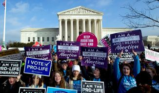 In this Jan. 18, 2019, photo, anti-abortion activists protest outside of the U.S. Supreme Court during the March for Life in Washington. Anti-abortion activists will gather in Washington on Friday, Jan. 24, 2020, for the annual march, eager to cheer on a continuous wave of federal and state abortion restrictions. (AP Photo/Jose Luis Magana) **FILE**