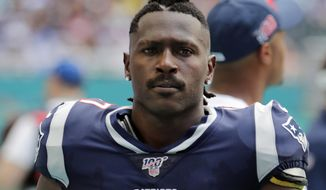 FILE - In this Sunday, Sept. 15, 2019, file photo, New England Patriots wide receiver Antonio Brown (17) on the sidelines,during the first half at an NFL football game against the Miami Dolphins in Miami Gardens, Fla. Authorities say NFL wide receiver Antonio Brown's trainer has been arrested following accusations that he and Brown attacked another man near Brown's Florida home. Hollywood police say officers responded to a disturbance call Tuesday, Jan. 21, 2020 where the alleged victim said Brown and his trainer, Glen Holt, hit him. Holt was arrested and charged with one count of burglary with battery.  (AP Photo/Lynne Sladky, File)