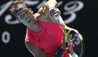 Spain's Rafael Nadal serves to Bolivia's Hugo Dellien during their first round singles match at the Australian Open tennis championship in Melbourne, Australia, Tuesday, Jan. 21, 2020. (AP Photo/Lee Jin-man)