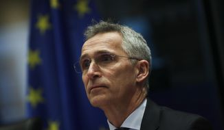 NATO Secretary-General Jens Stoltenberg addresses European Parliament Foreign Affairs committee members at the European Parliament in Brussels, Tuesday, Jan. 21, 2020. Stoltenberg told lawmakers that NATO needs to beef up its military training operation in Iraq once the government in Baghdad requests that it resume work. (AP Photo/Francisco Seco)