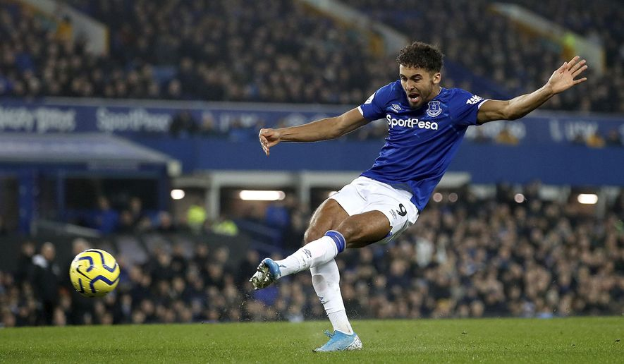 Everton's Dominic Calvert-Lewin scores his side's second goal of the game against Newcastle United during their English Premier League soccer match at Goodison Park in Liverpool, England, Tuesday Jan. 21, 2020. (Martin Rickett/PA via AP)
