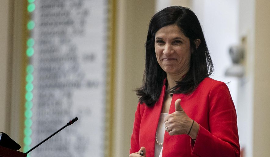"""In this Jan. 8, 2020, file photo, House Speaker Sara Gideon, D-Freeport, flashes a thumbs up at a Democratic colleague prior to the start of the first session of the new year at the State House House in Augusta, Maine. Planned Parenthood announced Tuesday that it is endorsing Gideon, a Democratic challenger to Republican Sen. Susan Collins in Maine, saying Collins """"turned her back"""" on women and citing her vote to confirm Brett Kavanaugh to the Supreme Court as well as other judicial nominees who oppose abortion.  (AP Photo/Robert F. Bukaty)"""