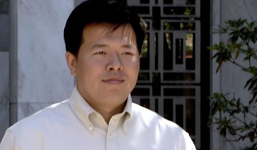 FILE - In this Sept. 22, 2005 file photo, Chen Gang, formerly of Beijing, China, leaves U.S. District Court in Hartford, Conn. Gang was among the plaintiffs in a lawsuit filed by Chinese citizens against Zhao Zhizhen, a Chinese television and radio executive they accuse of inciting torture against them because they were followers of Falun Gong. A federal appeals court ruling in New York on Tuesday, Jan. 21, 2020, rejected a request by members of the movement to file an amended lawsuit. (AP Photo/Bob Child, File)