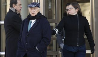 Jose Margulies, center, leaves federal court following his sentencing, Tuesday, Jan. 21, 2020, in the Brooklyn borough New York. A federal judge in Brooklyn sentenced Brazilian broadcast executive Margulies to two years' probation on Tuesday for acting as an intermediary in a scheme to exchange bribes for the media rights to South American soccer tournaments. (AP Photo/Mary Altaffer)