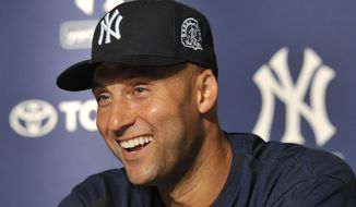 FILE - In this July 9, 2011, file photo, New York Yankees' Derek Jeter smiles as he speaks about his 3,000th career hit at a press conference after a baseball game against the Tampa Bay Rays, at Yankee Stadium in New York. Jeter could be a unanimous pick when Baseball Hall of Fame voting is announced Tuesday, Jan. 21, 2020. (AP Photo/Kathy Kmonicek)