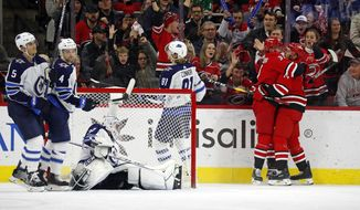 Carolina Hurricanes' Justin Williams (14), right, is congratulated on his goal by teammate Andrei Svechnikov (37), of Russia, during the third period of an NHL hockey game against the Winnipeg Jets in Raleigh, N.C., Tuesday, Jan. 21, 2020. (AP Photo/Karl B DeBlaker)