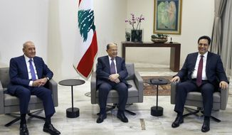 Lebanese President Michel Aoun, center, meets with Prime Minister-designate Hassan Diab, right, and Parliament Speaker Nabih Berri, left, at the Presidential Palace in Baabda, east of Beirut, Lebanon, Tuesday, Jan. 21, 2020. (AP Photo/Bilal Hussein)