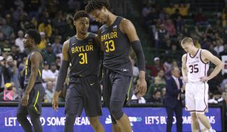 Baylor forward Freddie Gillespie (33) and Baylor guard MaCio Teague (31) smile in the second half of an NCAA college basketball game against Oklahoma Monday, Jan. 20, 2020, in Waco, Texas. (AP Photo/ Jerry Larson)