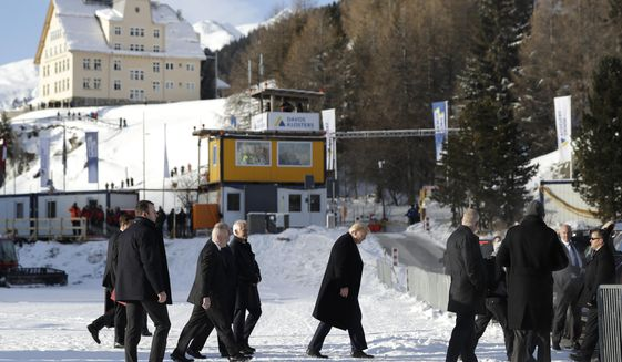 US President Donald Trump, center, arrives in Davos, Switzerland on Marine One, Tuesday, Jan. 21, 2020. President Trump arrived in Switzerland on Tuesday to start a two-day visit to the World Economic Forum. (AP Photo/Evan Vucci)