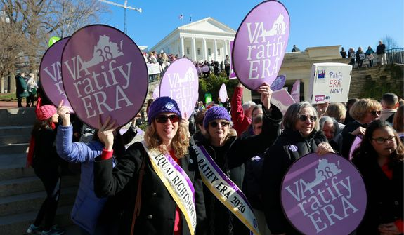 FILE - In this Wednesday, Jan. 8, 2020, file photo, Equal Rights Amendment supporters demonstrate outside Virginia State Capitol in Richmond, Va. Virginia moved a step closer to ratifying the Equal Rights Amendment on Tuesday, Jan. 1,4 2020, even as the measure's future nationally remains in doubt. A House committee approved a resolution to ratify the gender equality measure, which advocates hope will become the next amendment to the U.S. Constitution. (AP Photo/Steve Helber, File)