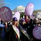 In this Wednesday, Jan. 8, 2020, photo, Equal Rights Amendment supporters demonstrate outside Virginia State Capitol in Richmond, Va. Virginia moved a step closer to ratifying the Equal Rights Amendment on Tuesday, Jan. 1,4 2020, even as the measure's future nationally remains in doubt. A House committee approved a resolution to ratify the gender equality measure, which advocates hope will become the next amendment to the U.S. Constitution. (AP Photo/Steve Helber) **FILE**