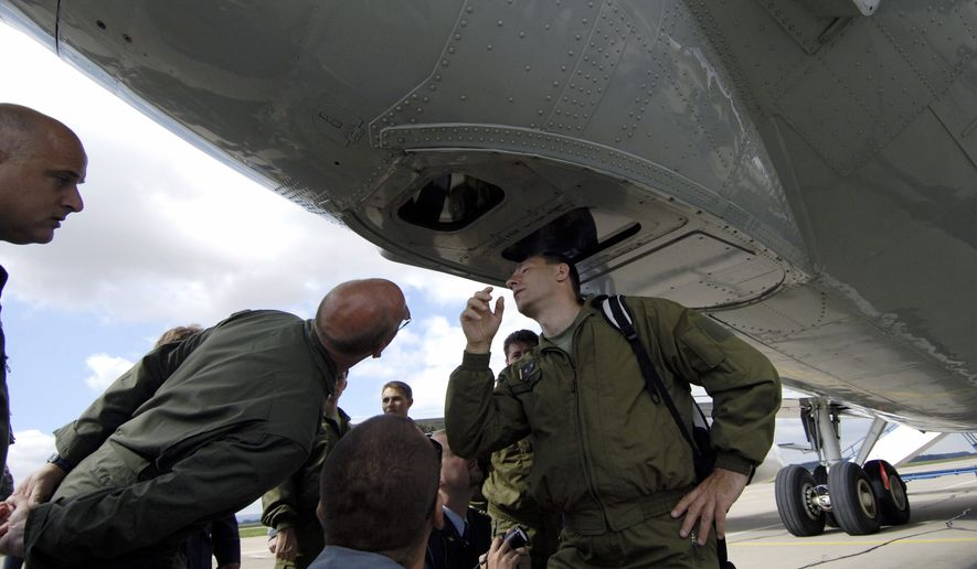 Czech soldiers inspect cameras installed on a U.S. Boeing B-707 OC-135B Observation Aircraft at the military airbase in Pardubice, Czech Republic, Tuesday, July 31, 2007, where a 31-member team of U.S. experts began training for surveillance missions to check military facilities in the Czech Republic within the Treaty on Open Skies. (AP Photo/CTK, Alexandra Mlejnkova) ** FILE **