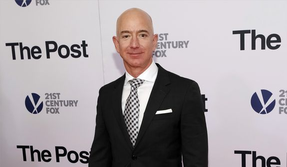 "In this Dec. 14, 2017, file photo, Jeff Bezos attends the premiere of ""The Post"" at The Newseum in Washington. United Nations experts on Wednesday, Jan. 22, 2020, have called for ""immediate investigation"" by the United States into information they received that suggests that Jeff Bezos' phone was hacked after receiving a file sent from Saudi Crown Prince Mohammed bin Salman's WhatsApp account. (Photo by Brent N. Clarke/Invision/AP, File)"