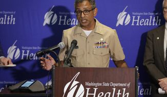 Dr. Satish Pillai, a medical officer with the U.S. Centers for Disease Control and Prevention, speaks Wednesday, Jan. 22, 2020, during a news conference in Shoreline, Wash. Pillai and other officials spoke about the ongoing response after a man in Washington state traveled to China and contacted the 2019 novel coronavirus. Officials said they are actively monitoring more than a dozen people who came into close contact with the man, who is doing well and is in an isolation unit in a hospital north of Seattle. (AP Photo/Ted S. Warren)