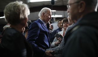 Democratic presidential candidate former Vice President Joe Biden meets with people during a campaign event at the North Iowa Events Center, Wednesday, Jan. 22, 2020, in Mason City, Iowa. (AP Photo/John Locher)