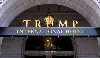 In this March 11, 2019, file photo, the Trump International Hotel is seen in Washington. District of Columbia Attorney General is suing President Donald Trump's inaugural committee and two companies that control the Trump International Hotel in D.C., accusing the groups of abusing nonprofit funds to benefit Trump's family.  (AP Photo/Mark Tenally)