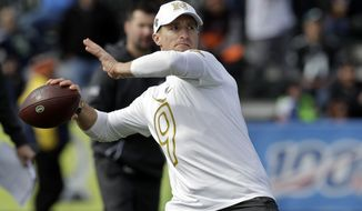 NFC quarterback Drew Brees, of the New Orleans Saints, throws a pass during a practice for the NFL Pro Bowl football game Wednesday, Jan. 22, 2020, in Kissimmee, Fla. (AP Photo/Chris O'Meara) ** FILE **
