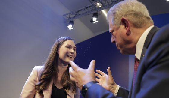 Finland's Prime Minister Sanna Marin and former U.S. Vice President Al Gore talk at the World Economic Forum in Davos, Switzerland, Wednesday, Jan. 22, 2020. The 50th annual meeting of the forum is taking place in Davos from Jan. 21 until Jan. 24, 2020. (AP Photo/Markus Schreiber)