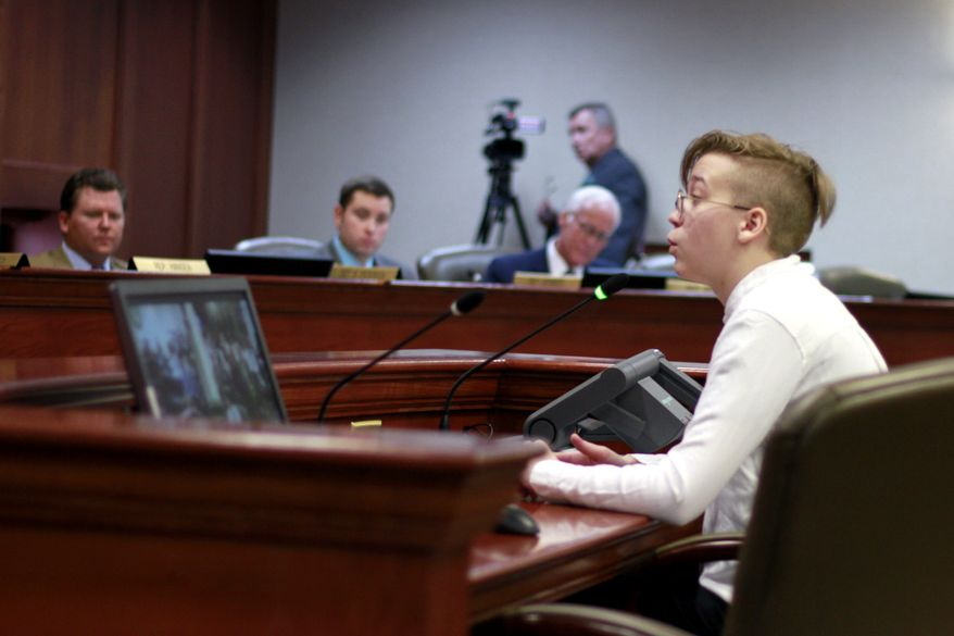 Quinncy Parke, 17, testifies to the South Dakota House State Affairs committee against a bill that would make it illegal for doctors to give gender-change treatment to children under 16, during a hearing Wednesday, Jan. 22, 2020 in Pierre, S.D. The South Dakota House committee passed a bill that would allow for the prosecution of physicians who help children under age 16 to change their gender. The bill would make it a Class 1 misdemeanor for medical providers in the state to perform surgeries, administer puberty-blocking medication or hormone therapy drugs to minors to change their gender. Nurses and other non-licensed medical practitioners would be exempt from prosecution. (AP Photo/Stephen Groves)