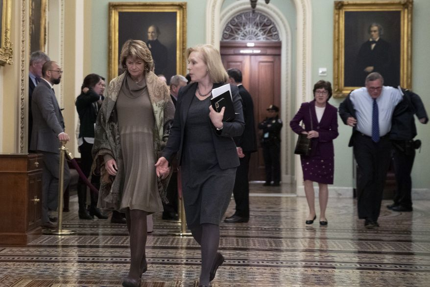 Sen. Lisa Murkowski, R-Alaska, , left, walks with Sen. Kirsten Gillibrand, D-N.Y., second from left, as Sen. Susan Collins, R-Maine, second from right, and Sen. Richard Burr, R-N.C., follow to the Senate chamber during the impeachment trial of President Donald Trump at the Capitol, Wednesday, Jan. 22, 2020, in Washington. (AP Photo/Steve Helber) **FILE**