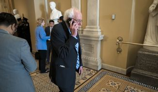Democratic presidential candidate, Sen. Bernie Sanders, I-Vt., makes a phone call during a break as the Senate continues with the impeachment trial of President Donald Trump on charges of abuse of power and obstruction of Congress, at the Capitol in Washington, Wednesday, Jan. 22, 2020. (AP Photo/J. Scott Applewhite)