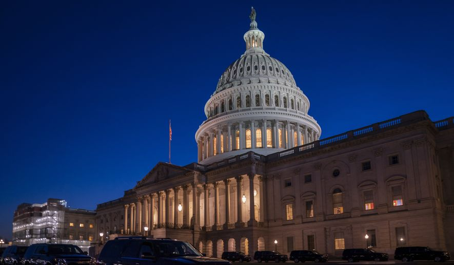 """Night falls on the Capitol in Washington, Wednesday evening, Jan. 22, 2020, during the impeachment trial of President Donald Trump. House prosecutors are outlining what they refer to as President Donald Trump's """"corrupt scheme"""" to abuse power and obstruct Congress as they open six days of arguments in his impeachment trial. (AP Photo/J. Scott Applewhite)"""