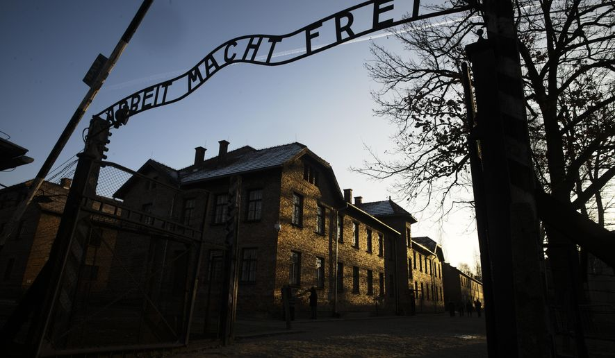 FILE - In this Dec. 6, 2019, file photo, the sun lights the buildings behind the entrance of the former Nazi death camp of Auschwitz-Birkenau in Oswiecim, Germany. World leaders will gather twice to mark the 75th anniversary of the liberation of the Auschwitz-Birkenau concentration camp _ once on Thursday, Jan. 23, 2020, in Jerusalem and again on Jan. 27 at the Auschwitz site in southern Poland. The fact that there will be two competing ceremonies reflects how politically charged World War II remains for nationalist governments in Russia and Poland. (Photo/Markus Schreiber, File)