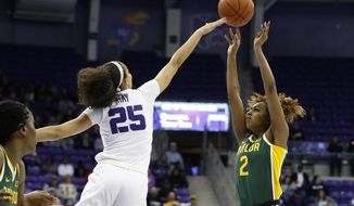 Baylor guard DiDi Richards (2) shoots over TCU guard Kianna Ray (25) during the first half of an NCAA college basketball game in Fort Worth, Texas, Wednesday, Jan. 22, 2020. (AP Photo/Ray Carlin)