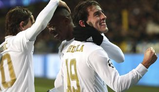 Real Madrid's Vinicius Junior, center, jubilates with teammate Real Madrid's Alvaro Odriozola, right, after scoring his sides second goal during the Champions League group A soccer match between Brugge and Real Madrid at the Jan Breydel stadium in Bruges, Belgium, Wednesday, Dec. 11, 2019. (AP Photo/Francisco Seco)