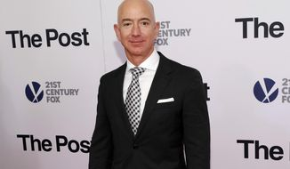 "FILE - In this Dec. 14, 2017, file photo, Jeff Bezos attends the premiere of ""The Post"" at The Newseum in Washington. United Nations experts on Wednesday, Jan. 22, 2020 have called for ""immediate investigation"" by the United States into information they received that suggests that Jeff Bezos' phone was hacked after receiving a file sent from Saudi Crown Prince Mohammed bin Salman's WhatsApp account. (Photo by Brent N. Clarke/Invision/AP, File)"