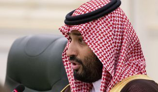 "FILE - In this Oct. 14, 2019 file photo, Saudi Arabia's Crown Prince Mohammed bin Salman speaks to Russian President Vladimir Putin during the talks in Riyadh, Saudi Arabia.  United Nations experts Wednesday, Jan. 22, 2020 called for an ""immediate investigation"" by the United States and others into information they received that suggests that Jeff Bezos' phone was hacked after receiving a file sent from Saudi Crown Prince Mohammed bin Salman's WhatsApp account. (AP Photo/Alexander Zemlianichenko, Pool)"
