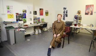 Academy Award-winning actress Tilda Swinton is photographed at Slade School of Fine Art, London, Wednesday Jan. 22, 2020, during the launch to urge art-lovers to contribute to an appeal to save the home of late British artist and filmmaker Derek Jarman for the public. (Ian West/PA via AP)