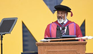 File-This May, 4, 2019, file photo shows University of Michigan Provost Martin Philbert who has been placed on administrative leave during an investigation into allegations of sexual misconduct, the school said Wednesday. Philbert speaks during commencement exercises in Ann Arbor, Mich. (Max Ortiz/Detroit News via AP, File)