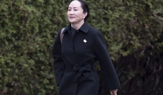 Meng Wanzhou, chief financial officer of Huawei, leaves her home to go to B.C. Supreme Court in Vancouver, Wednesday, January 22, 2020. Wanzhou is in court for hearings over an American request to extradite the executive of the Chinese telecom giant Huawei on fraud charges. (Jonathan Hayward/The Canadian Press via AP)