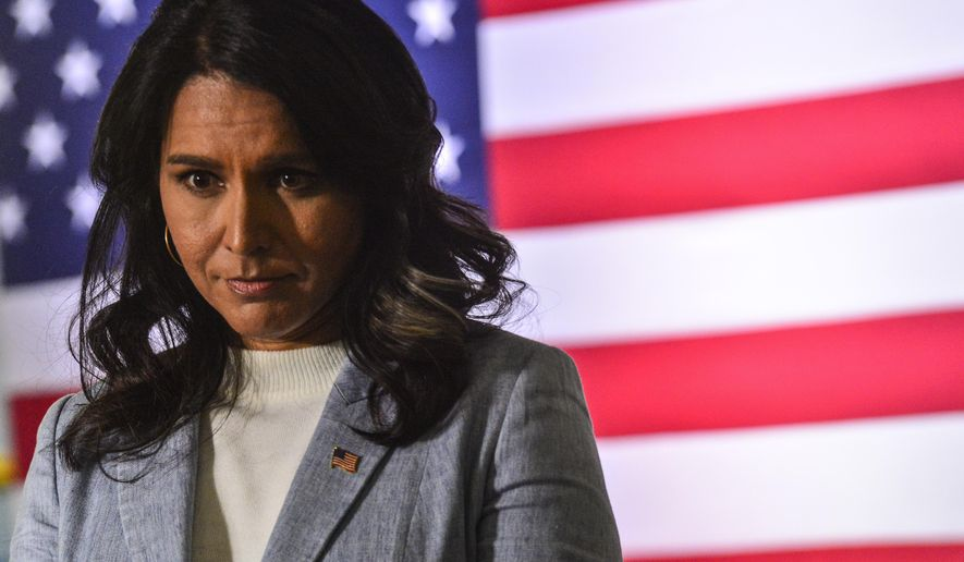 Democratic presidential candidate U.S. Rep. Tulsi Gabbard, of Hawaii, hosts a town hall meeting at the Keene Public Library, Tuesday, Jan. 21, 2020, in Keene, N.H. (Kristopher Radder/The Brattleboro Reformer via AP)