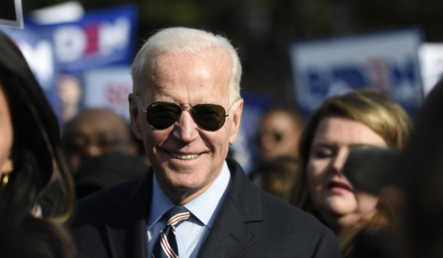 Democratic presidential hopeful Joe Biden participates in a Dr. Martin Luther King Jr. Day march on Monday, Jan. 20, 2020, in Columbia, S.C. (AP Photo/Meg Kinnard)