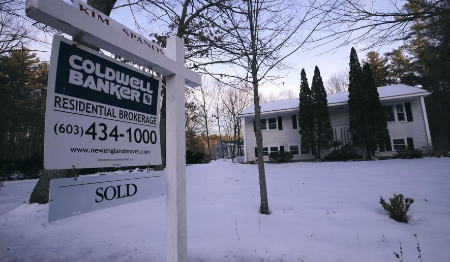 This Jan. 9, 2020, photo shows a sold sign is posted on a real estate sign outside a home in Derry, N.H. On Wednesday, Jan. 22, the National Association of Realtors reports on sales of existing homes in December. (AP Photo/Charles Krupa)